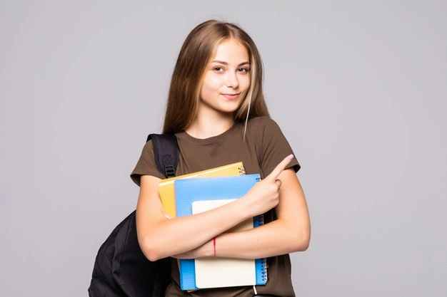 portrait-cute-young-brunette-student-holding-exercise-books-isolated-white-wall_231208-11488_11zon